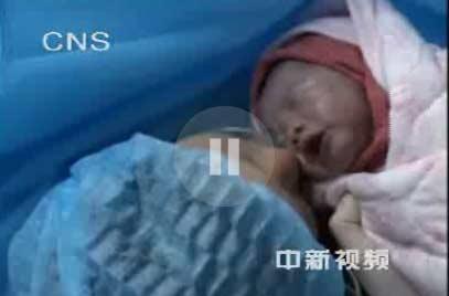 灾区地震一视频v灾区战婴儿剖腹产出生取名震奥医院绿底图片